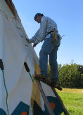 Putting the tipi cover together with lacing pins